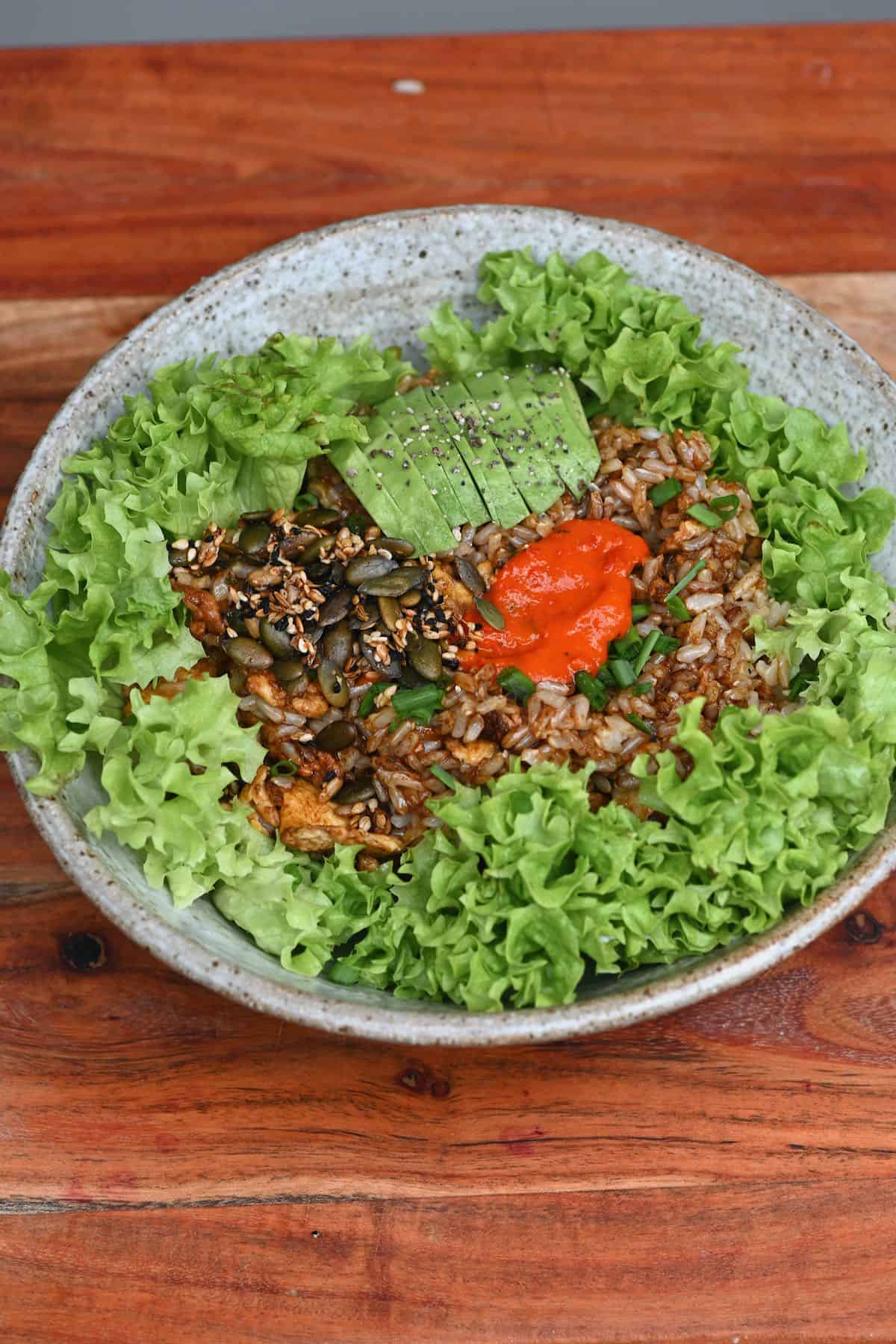 Rice eggs breakfast served over lettuce leaves