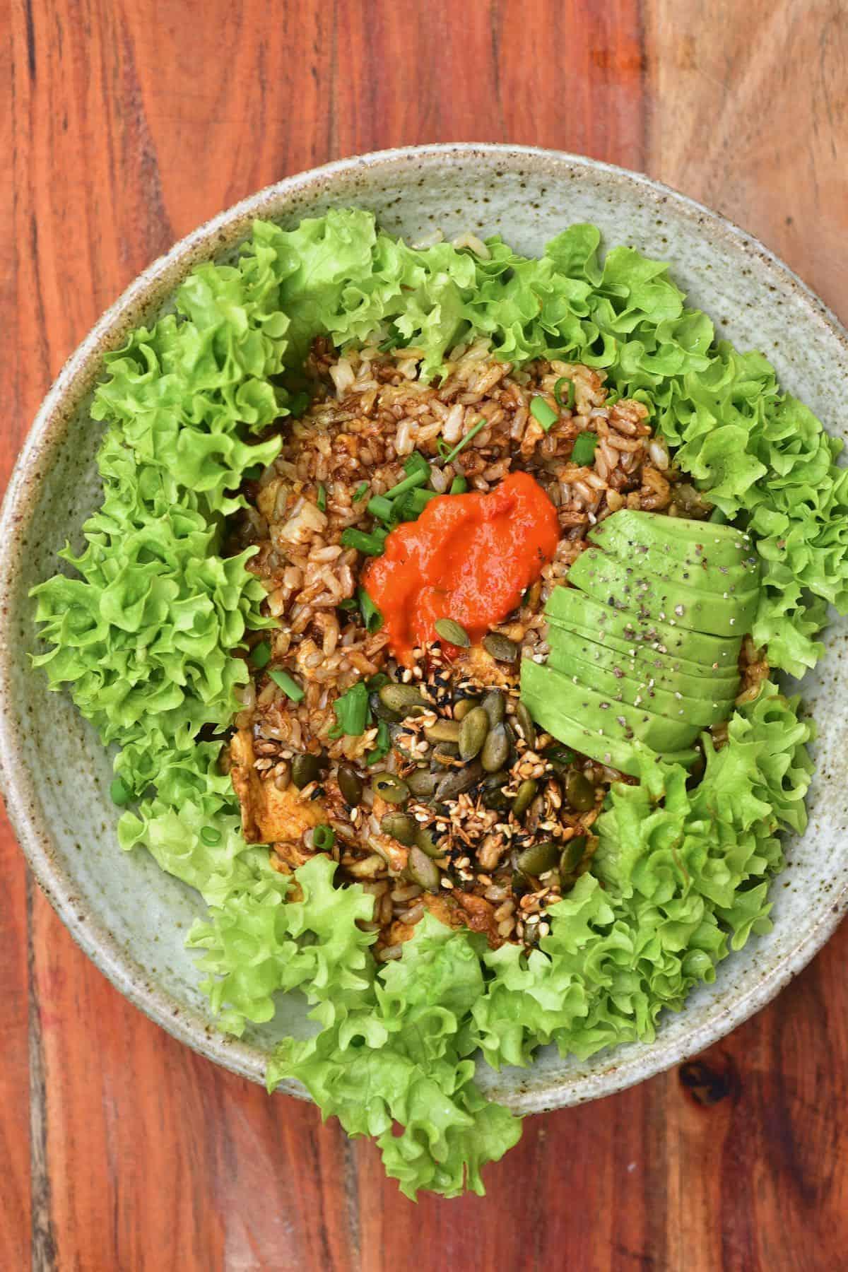 Rice breakfast served over lettuce