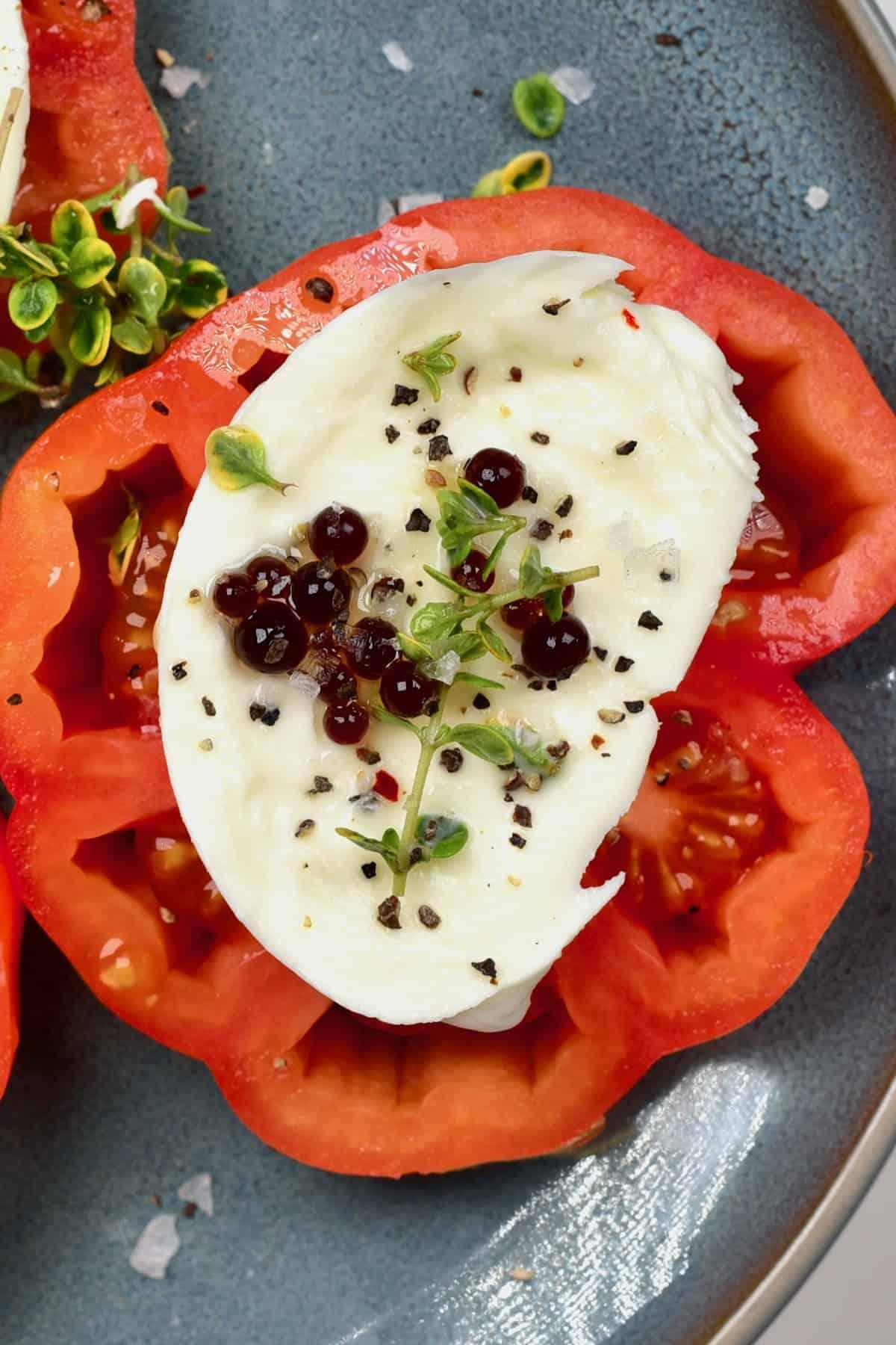 Balsamic vinegar over tomato mozzarela salad
