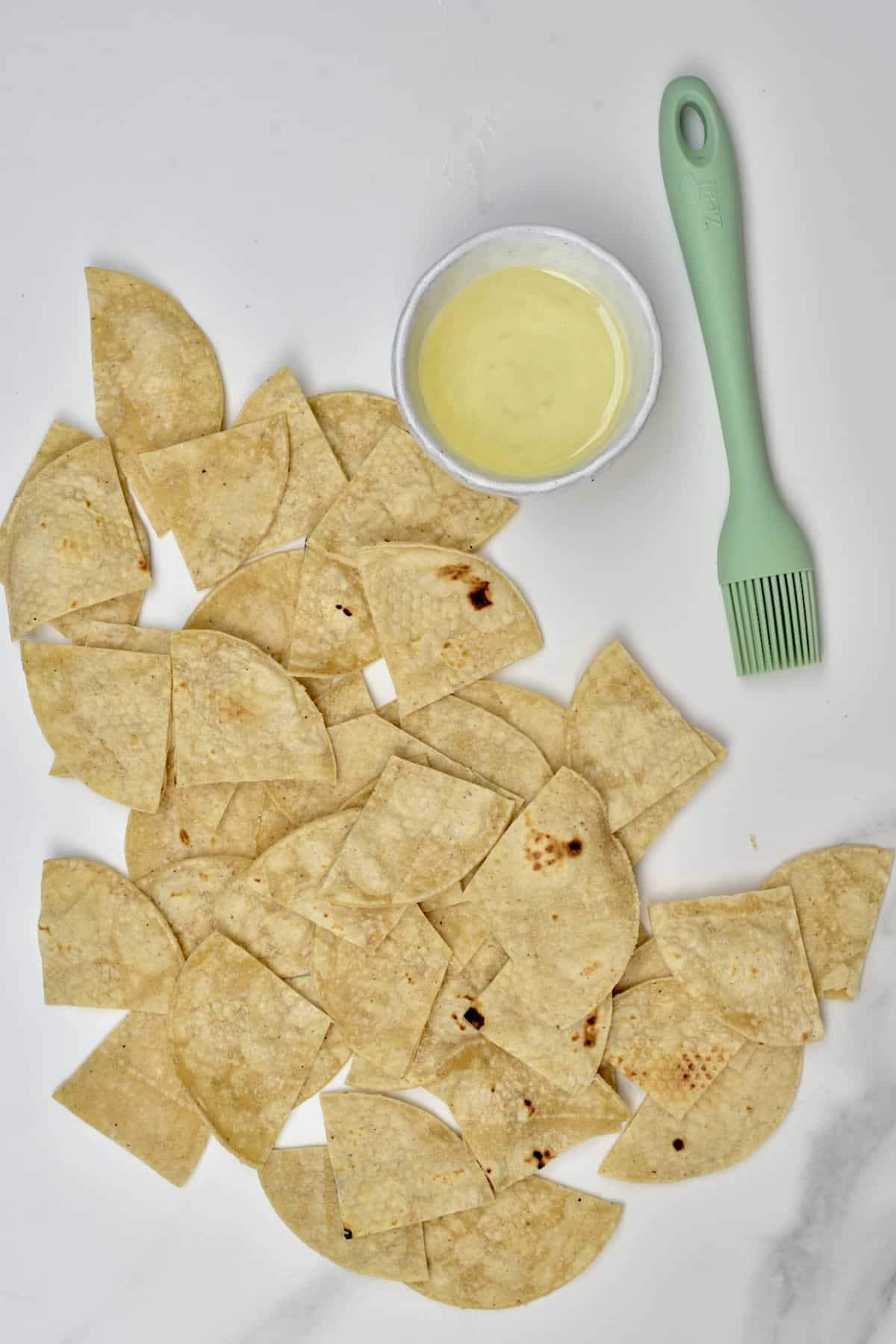 Corn tortilla chips and olive oil