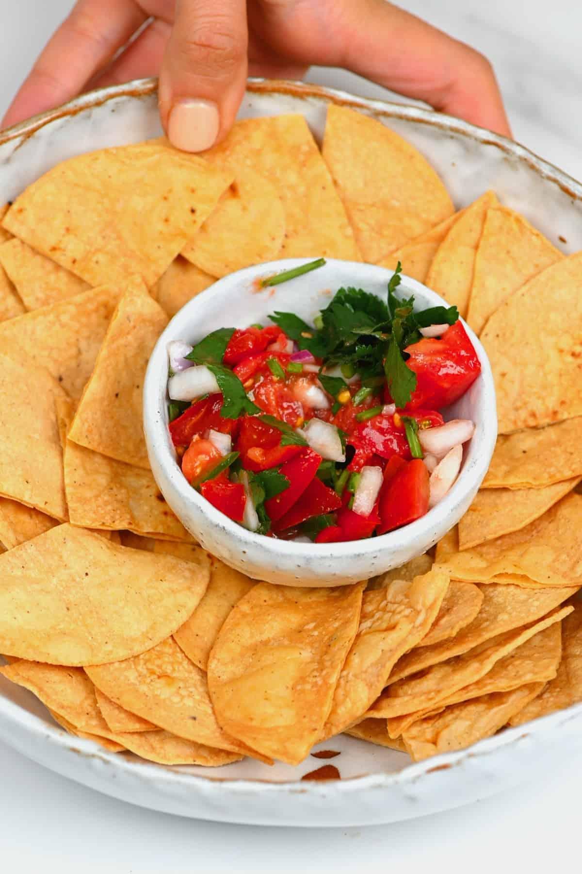 Corn tortilla chips in a bowl with pico de gallo
