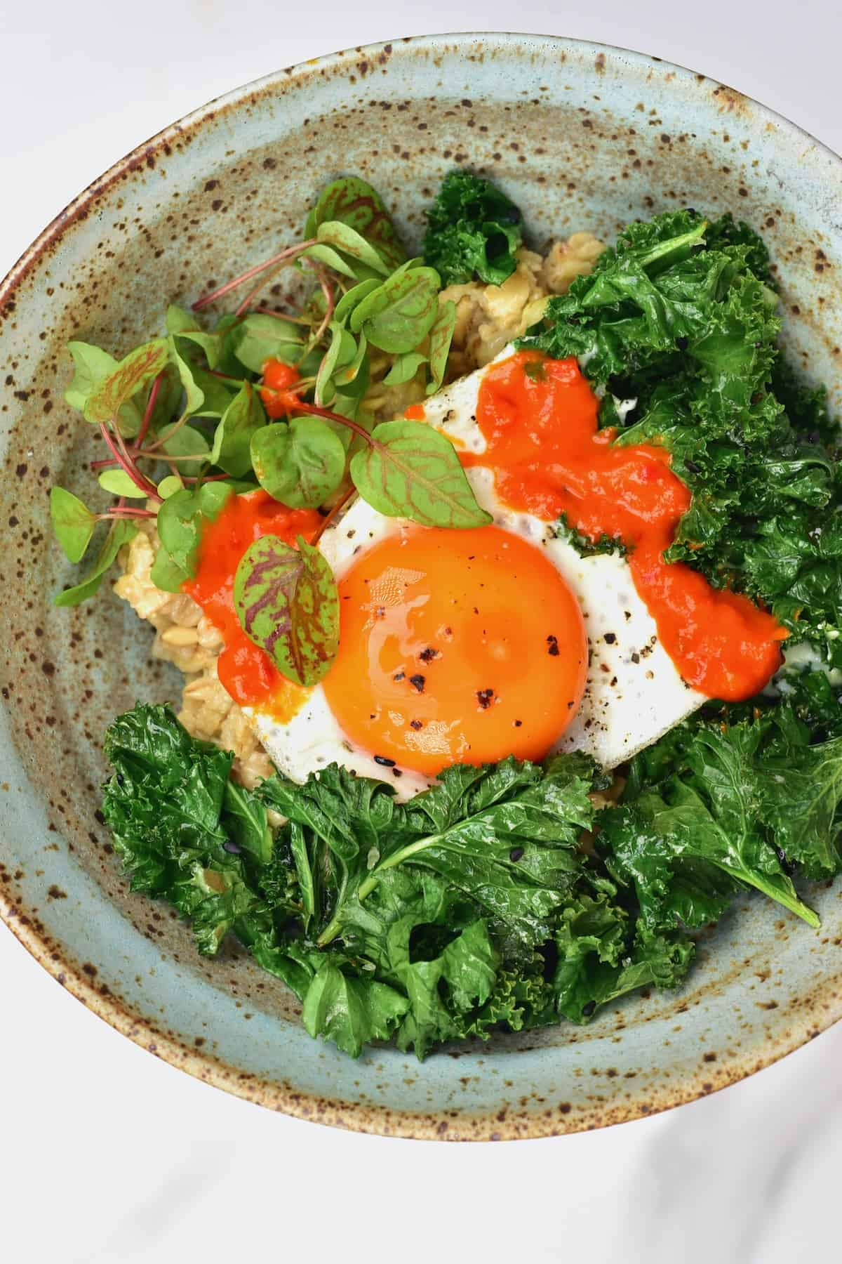 Oatmeal egg and kale in a bowl
