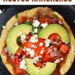 Huevos rancheros topped with avocado