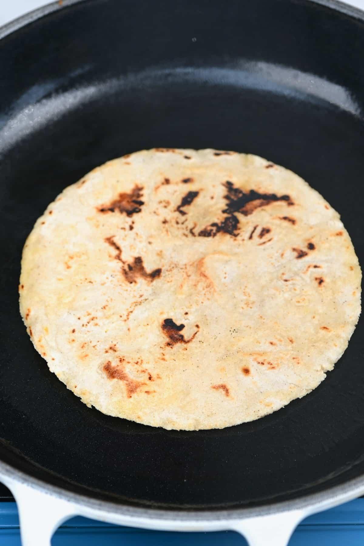 Fried corn tortilla in a pan