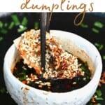 Dipping a dumpling in sauce
