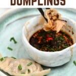 Mushroom dumpling being dipped in gyoza sauce