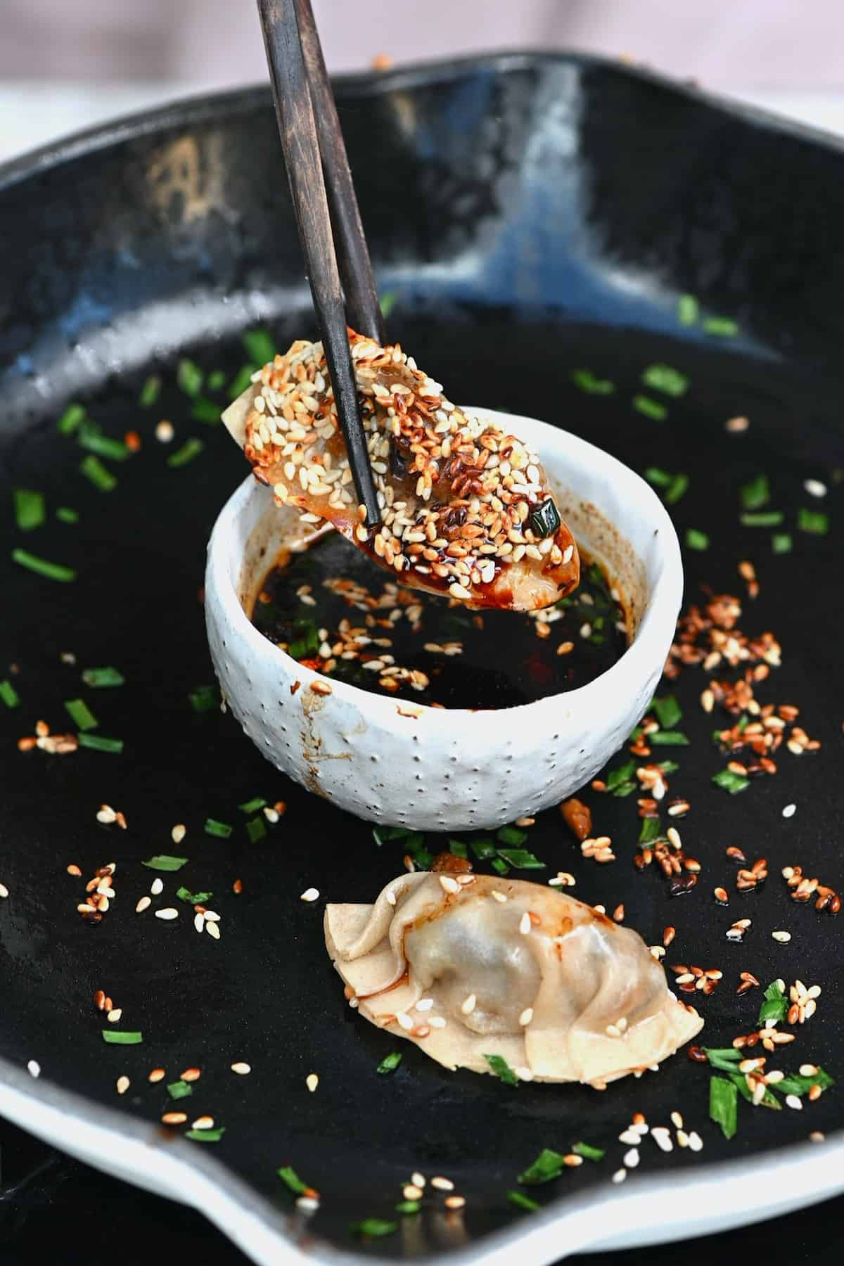 Potsticker in a dipping sauce