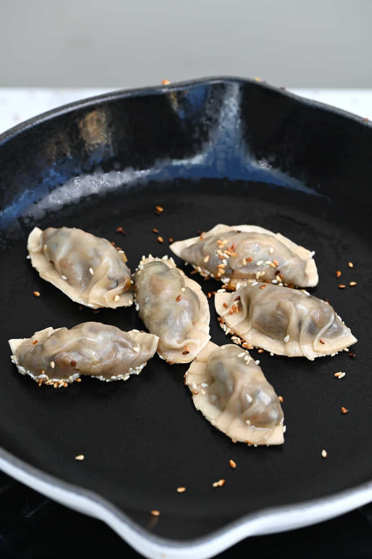 Searing dumplings on a pan