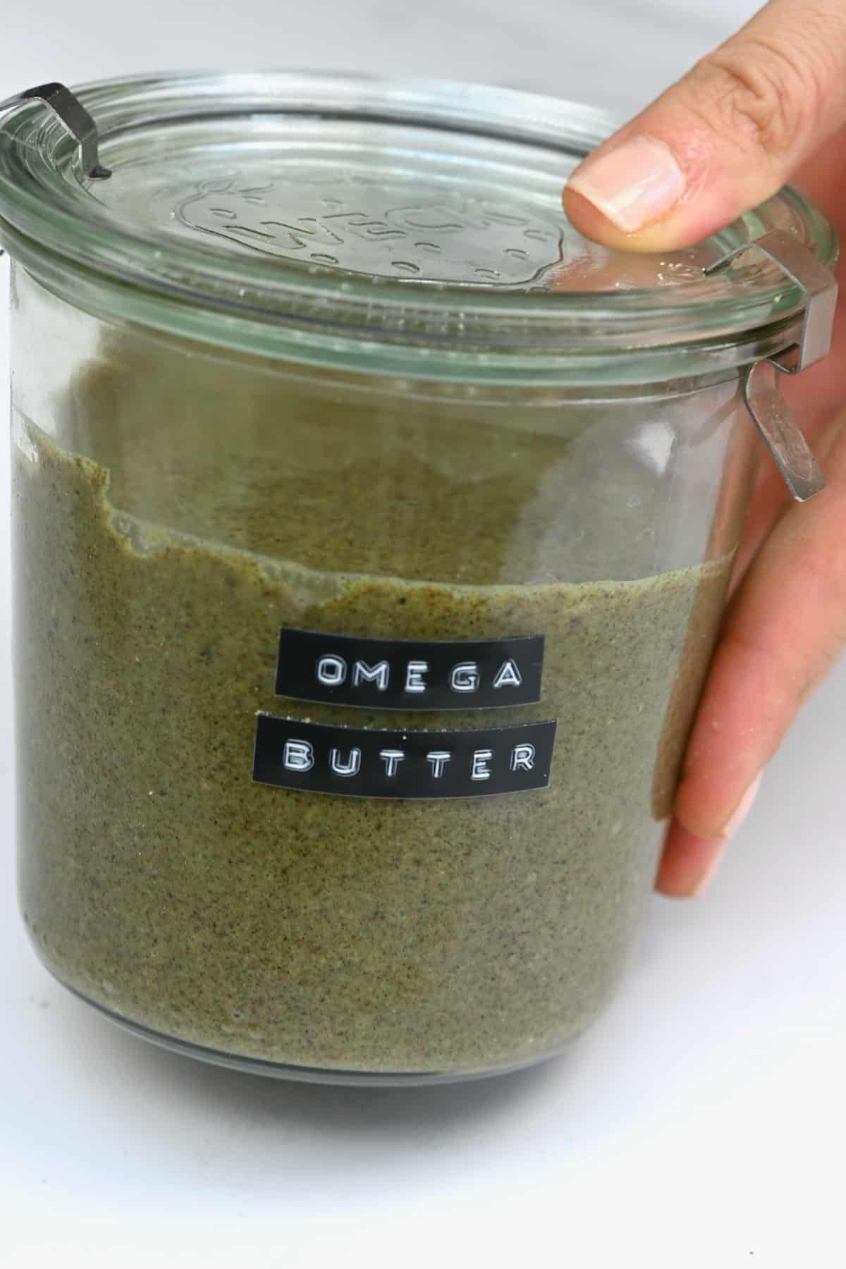 A jar with omega seed butter