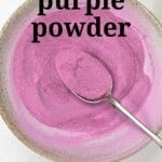 A bowl and spoon filled with purple sweet potato powder