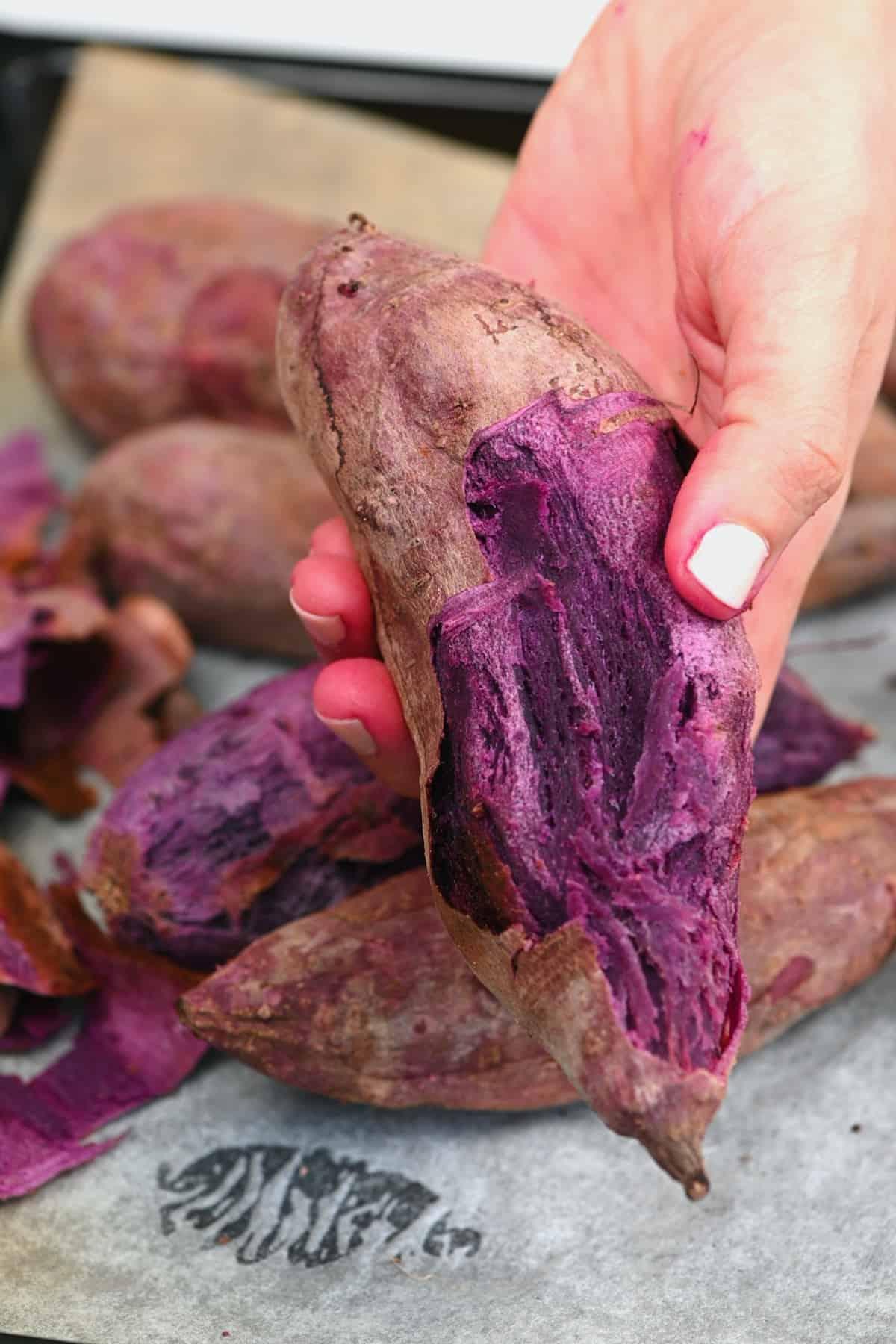 Peeling a baked purple potato