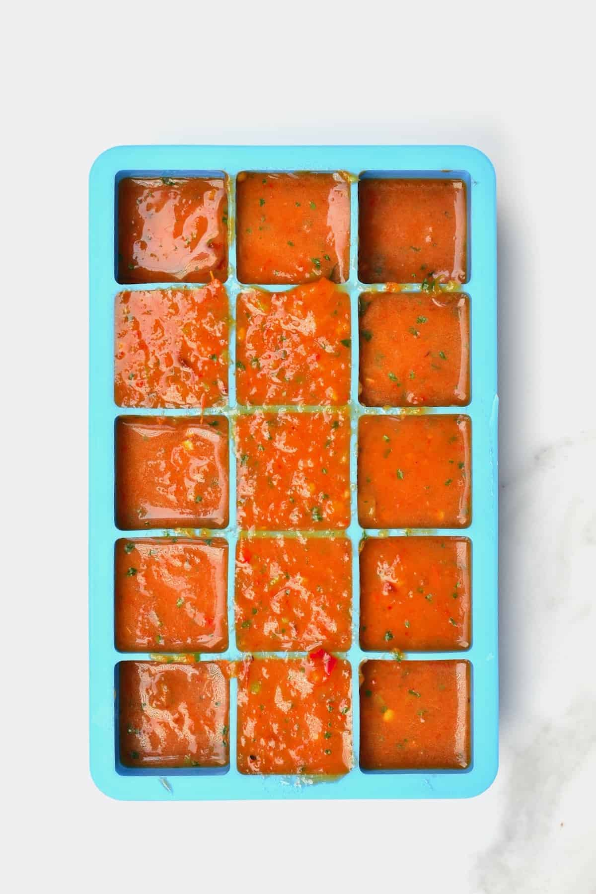 Salsa roja in ice cube tray
