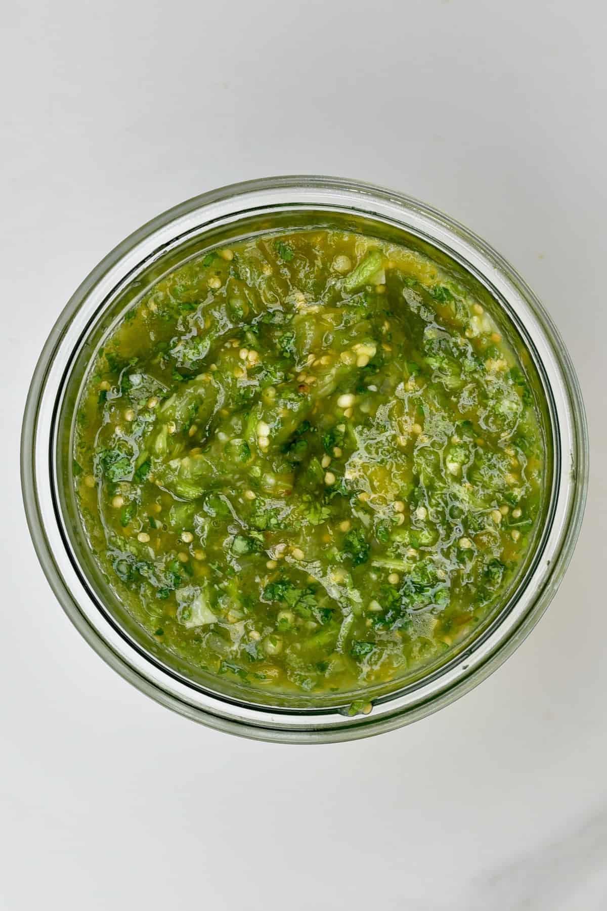 tomatillo green chili salsa in a jar