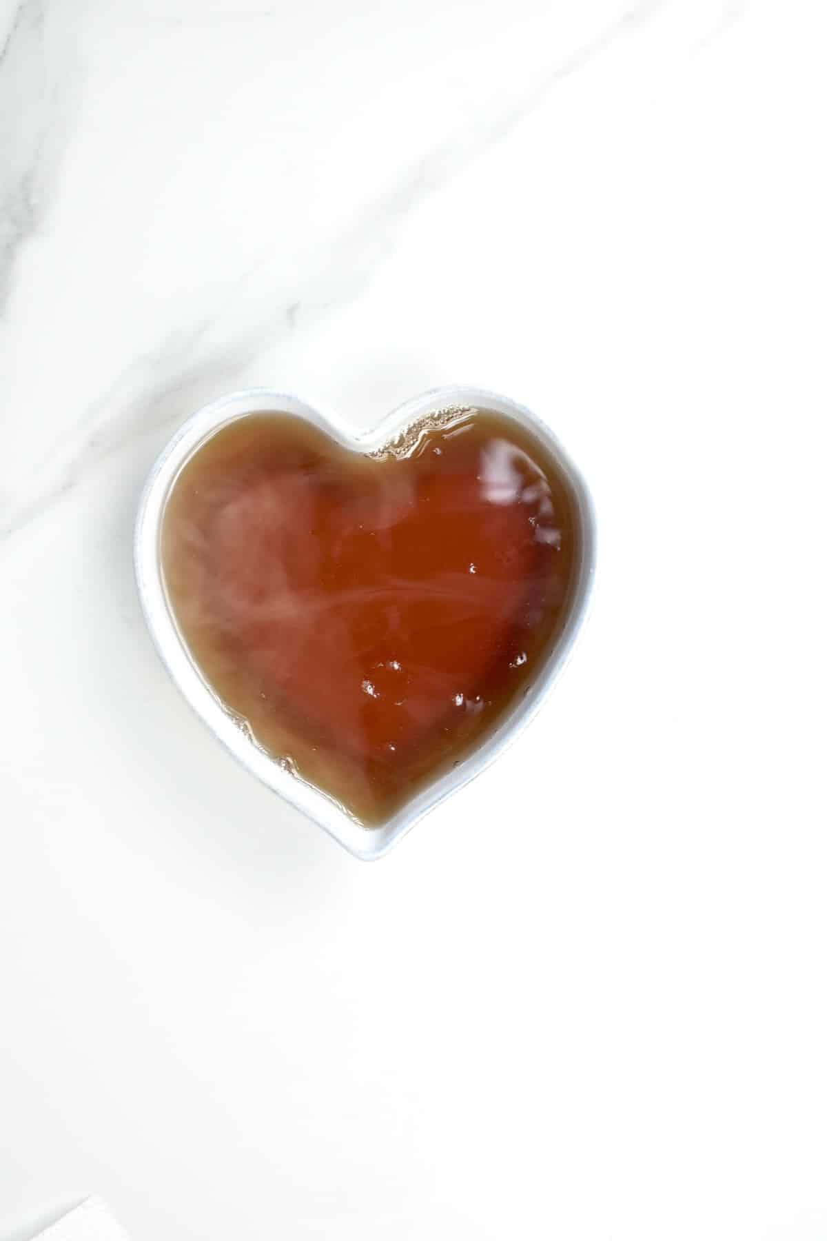 A heart shaped bowl with sugar syrup