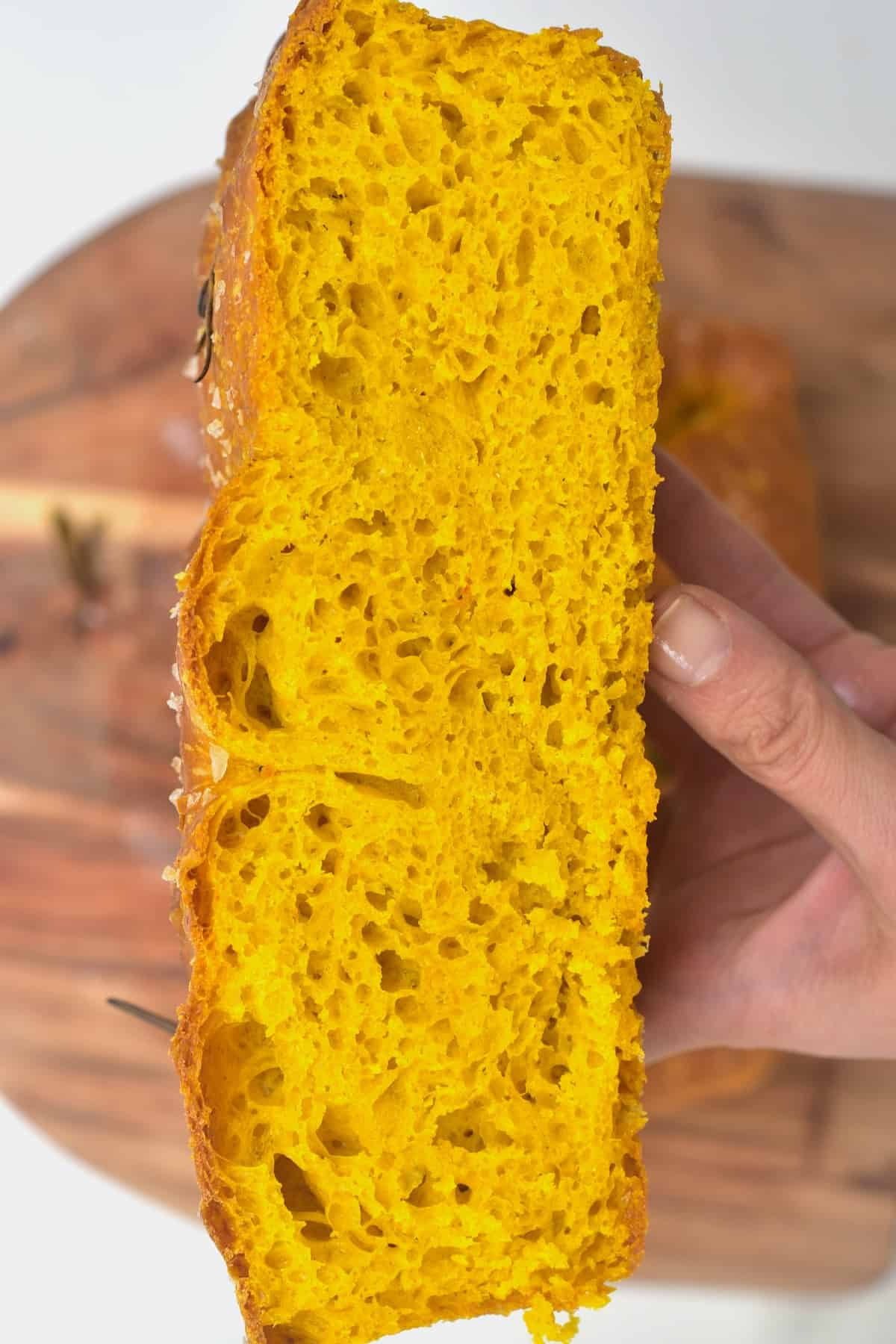 A slice of turmeric focaccia