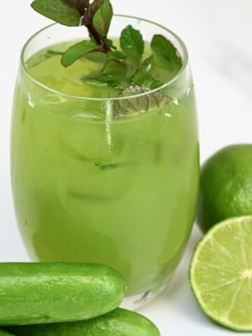 Cucumber lemonade in a glass topped with mint