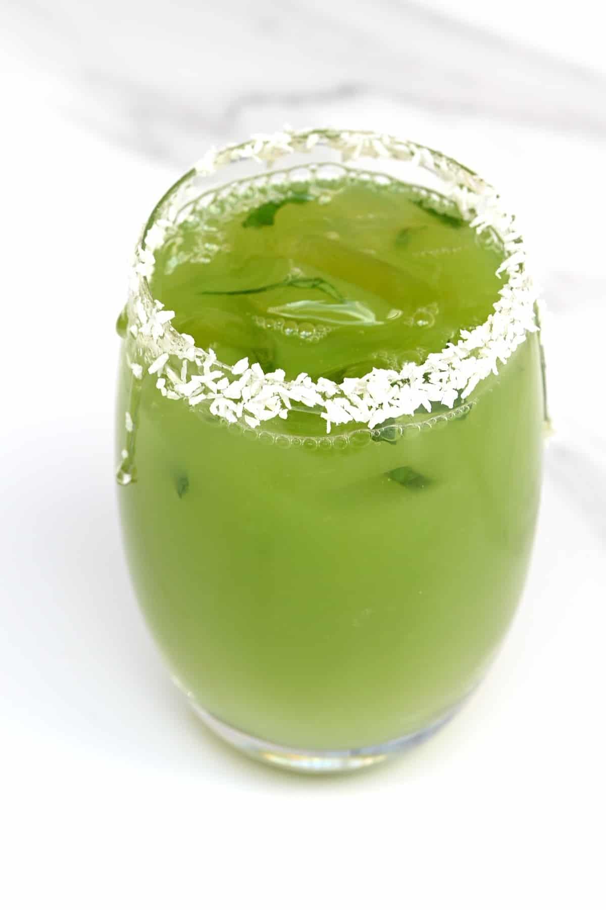 A glass with cucumber lemonade