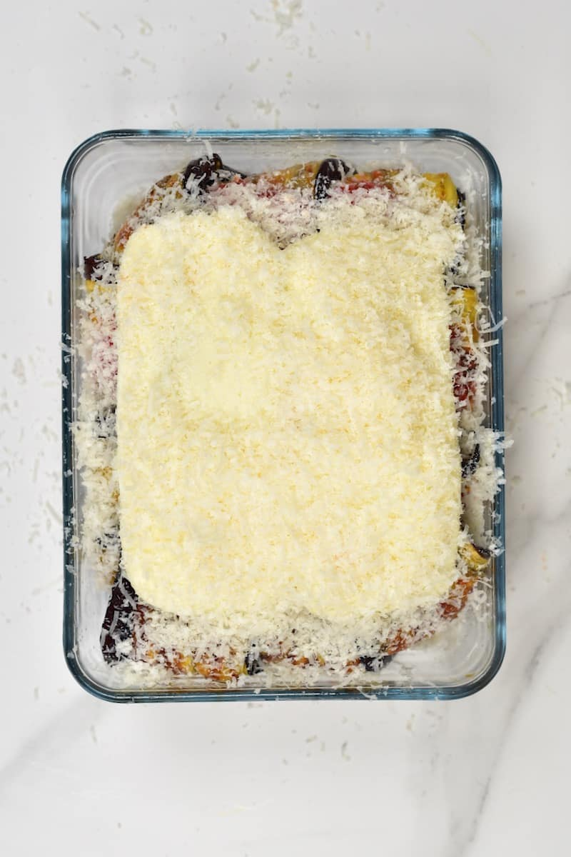 Parmigiana topped with cheese ready to bake