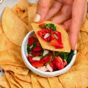 Tortilla chip topped with pico de gallo