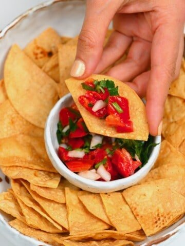 Tortilla chip topped with pico de gallo