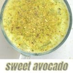 Top view of avocado shake topped with ground pistachio