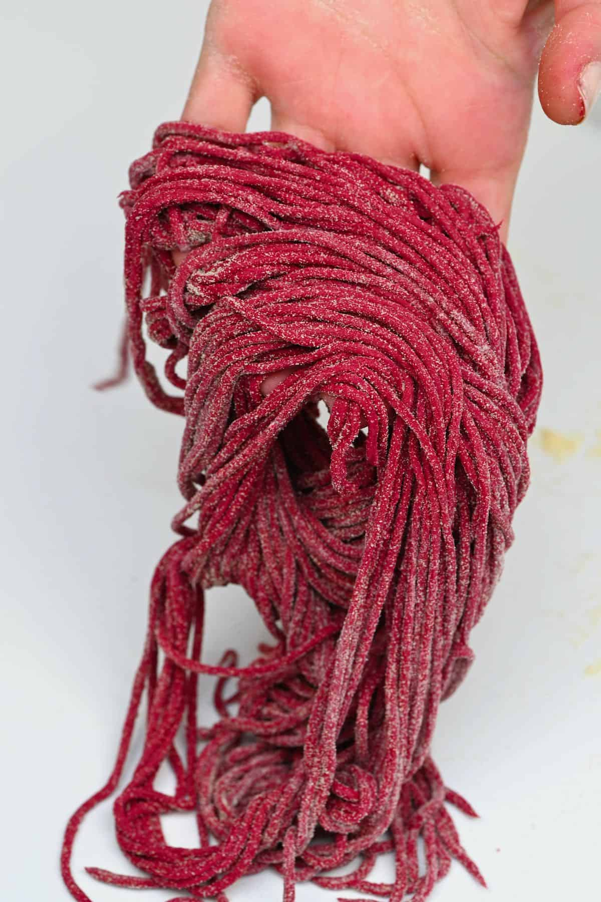 A handful of beetroot pasta