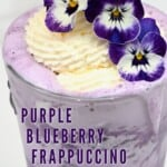 Blueberry frappuccino with whipped cream and edible flowers