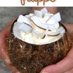 Coconut vanilla frappe served in a coconut bowl topped with coconut flakes