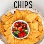 Homemade corn tortilla chips in a bowl with pico de gallo salsa