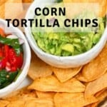 Homemade corn tortilla chips in a bowl with guacamole