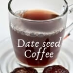 Date seed coffee in a glass mug and two dates next to it