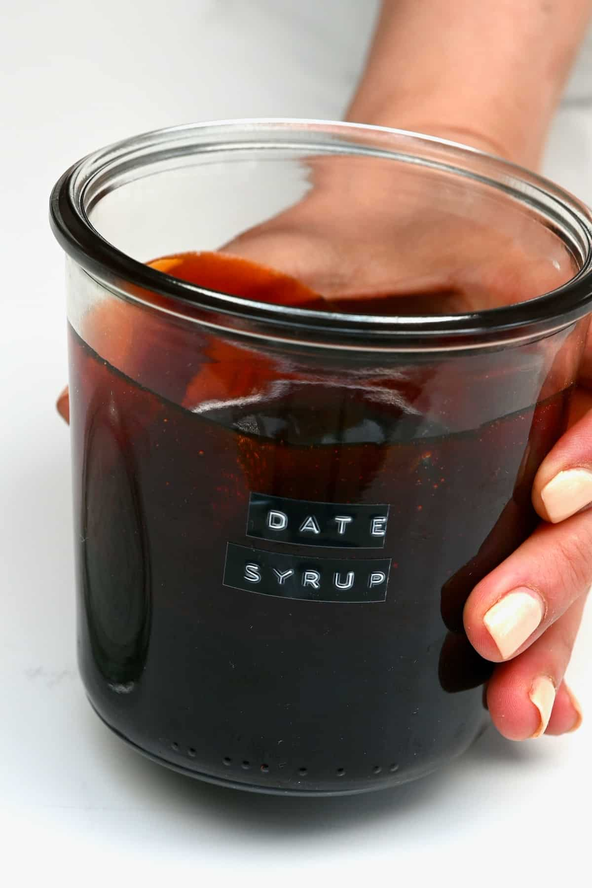 Date syrup in a jar