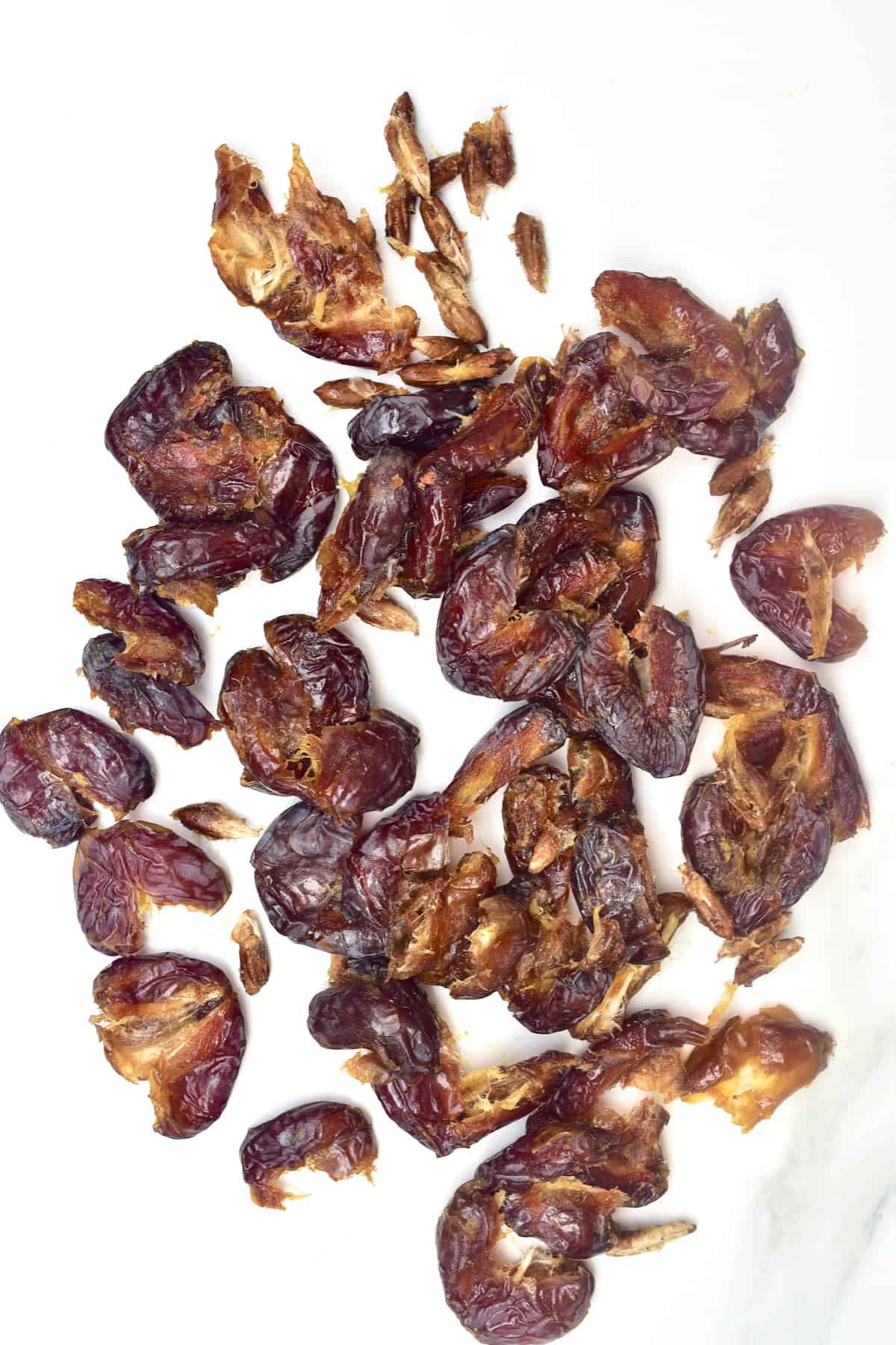 Pitted dates on a flat surface