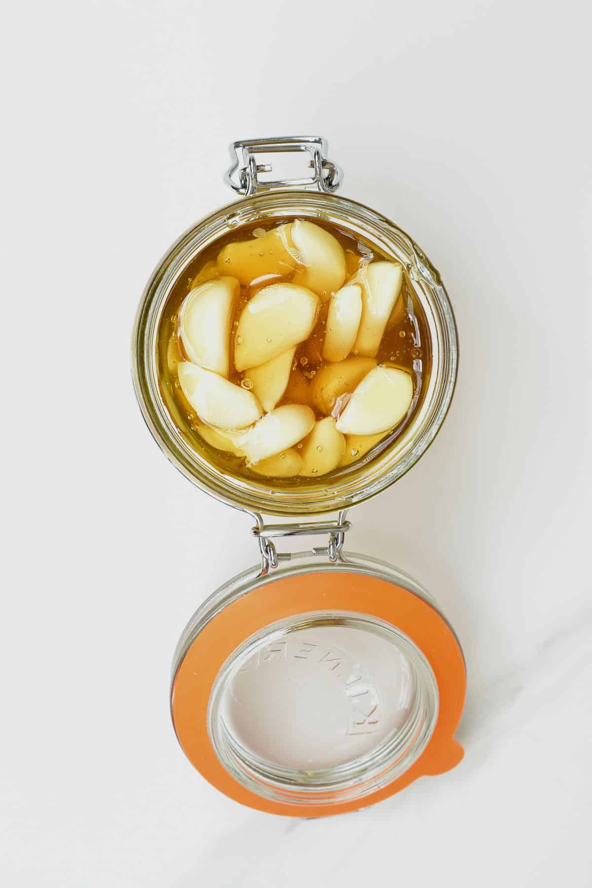 Top view of garlic and honey in a jar