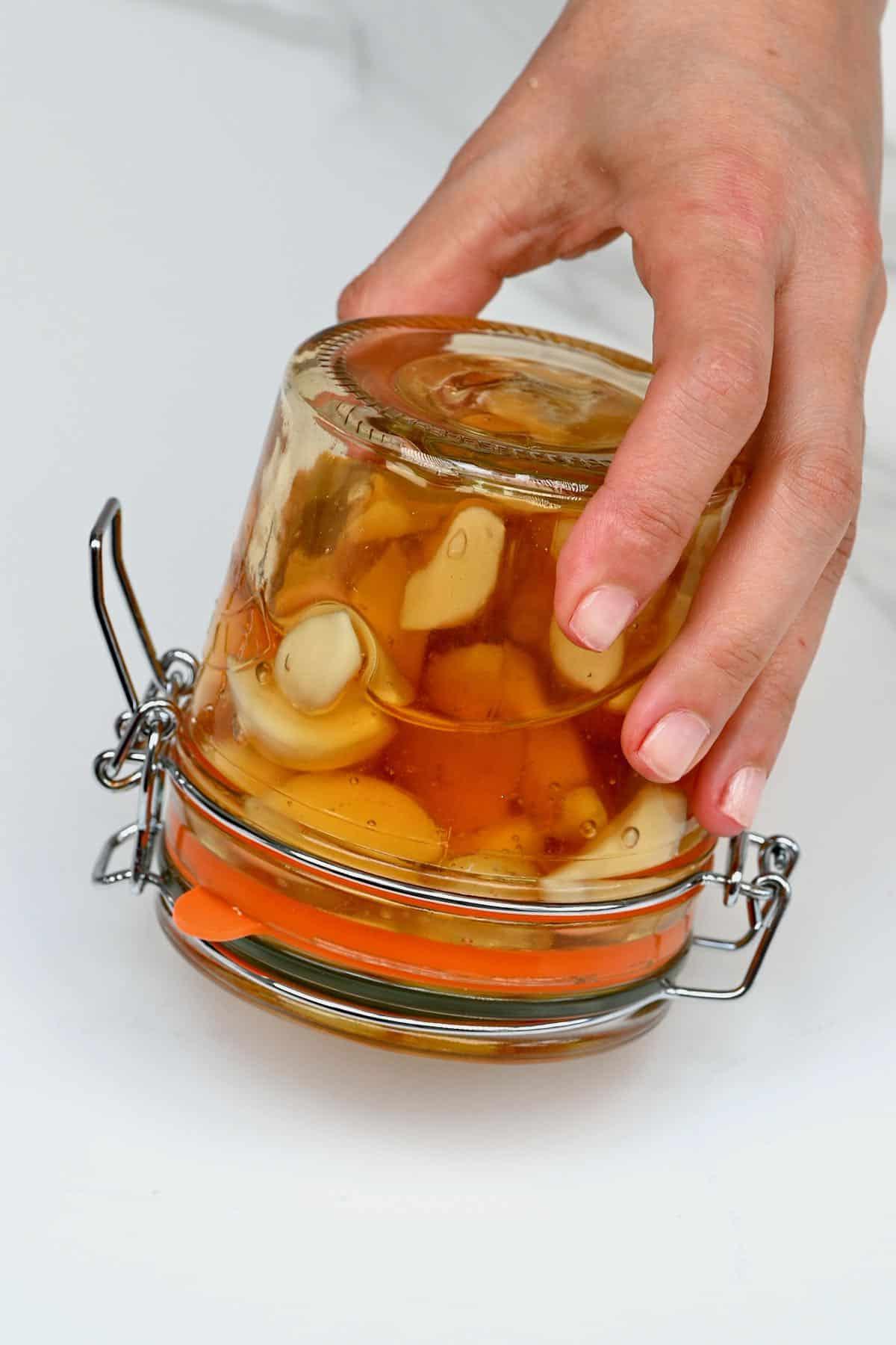 Upside down jar with fermented honey garlic