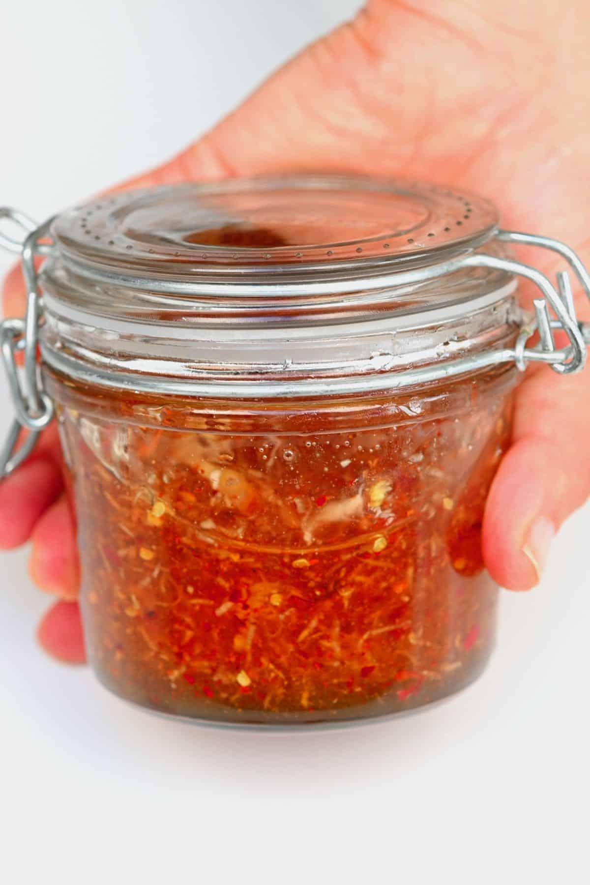 A jar with garlic chili honey