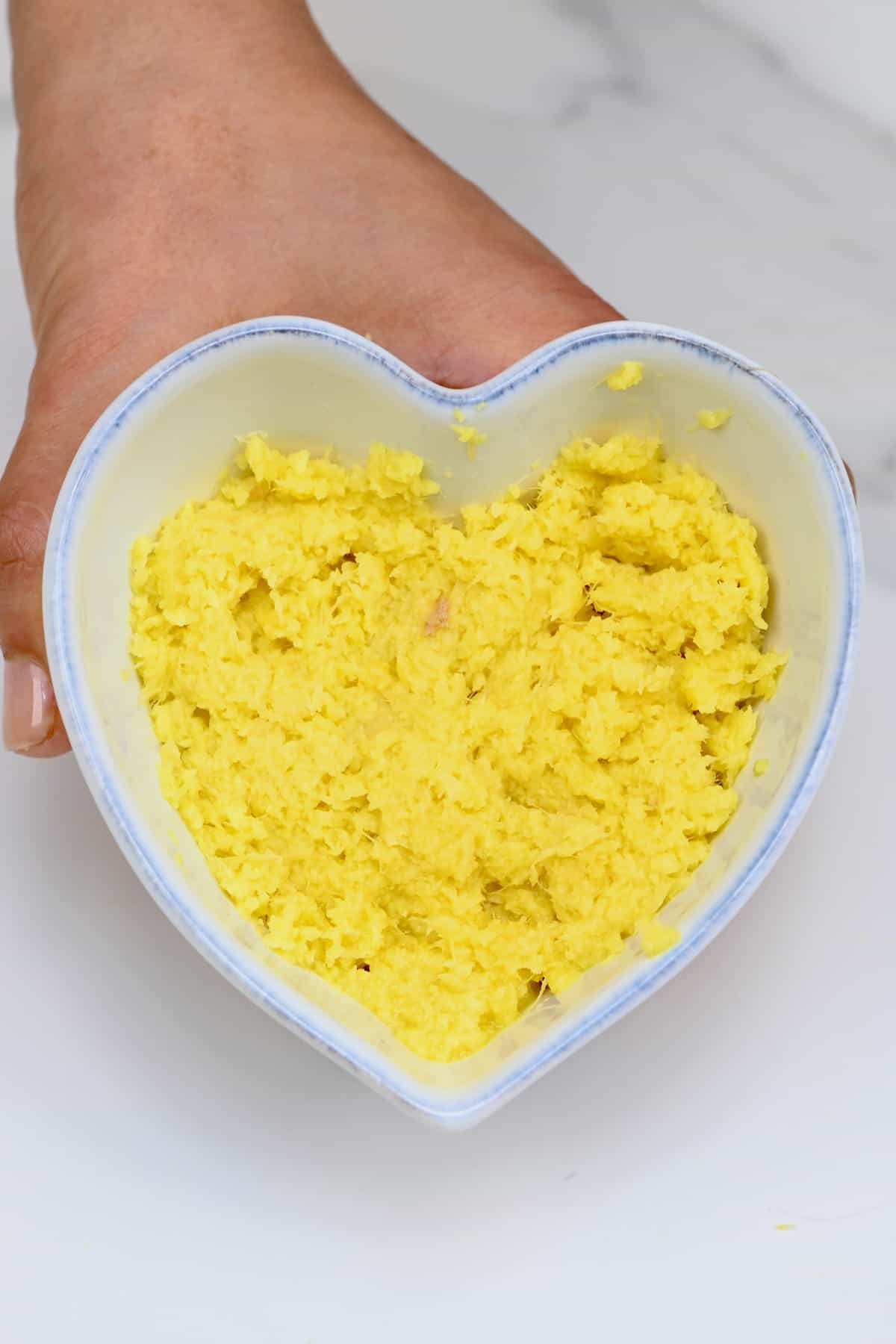 Ginger paste in a heart-shaped bowl
