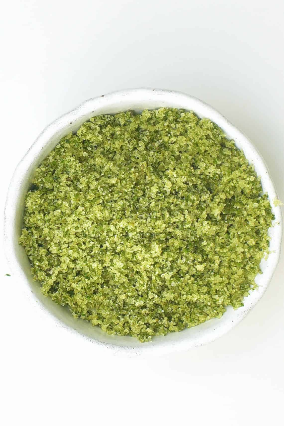 A small bowl with herb salt from fresh herbs