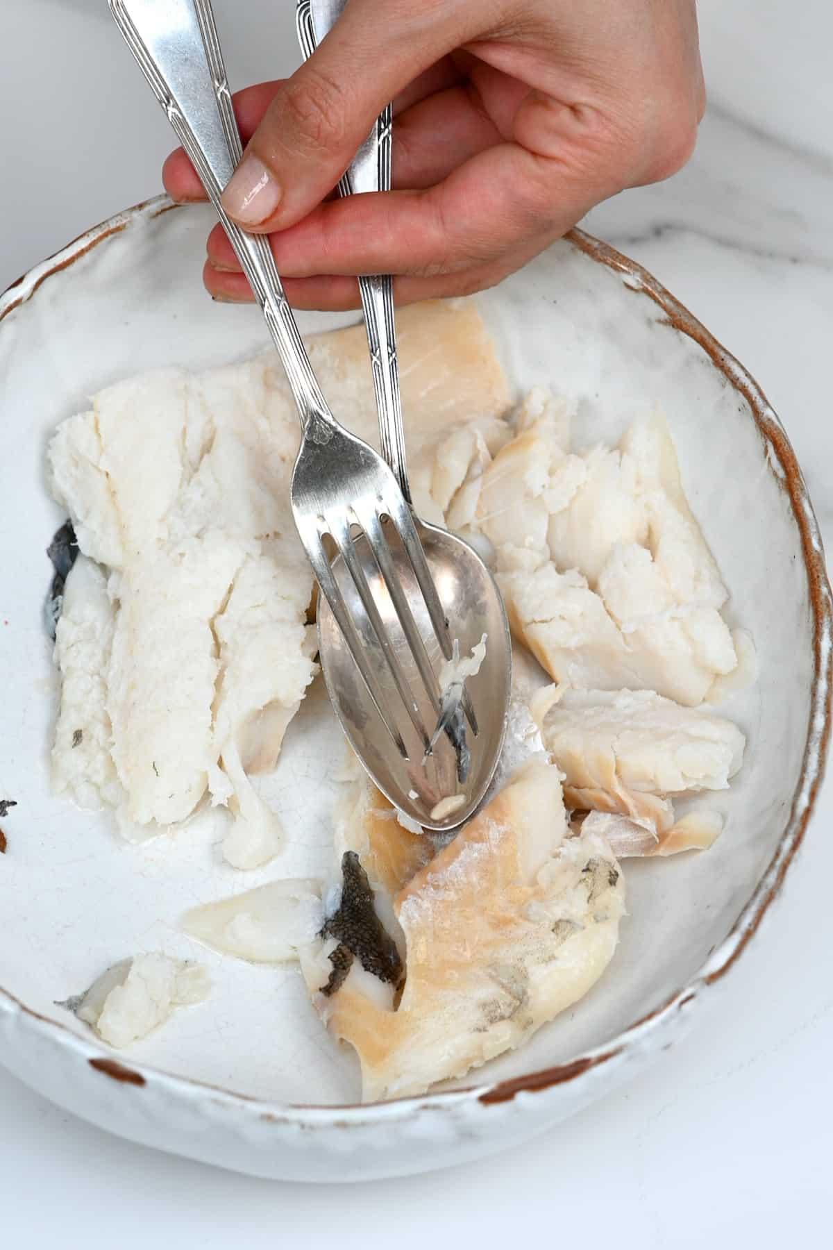 Deboning a cooked fish