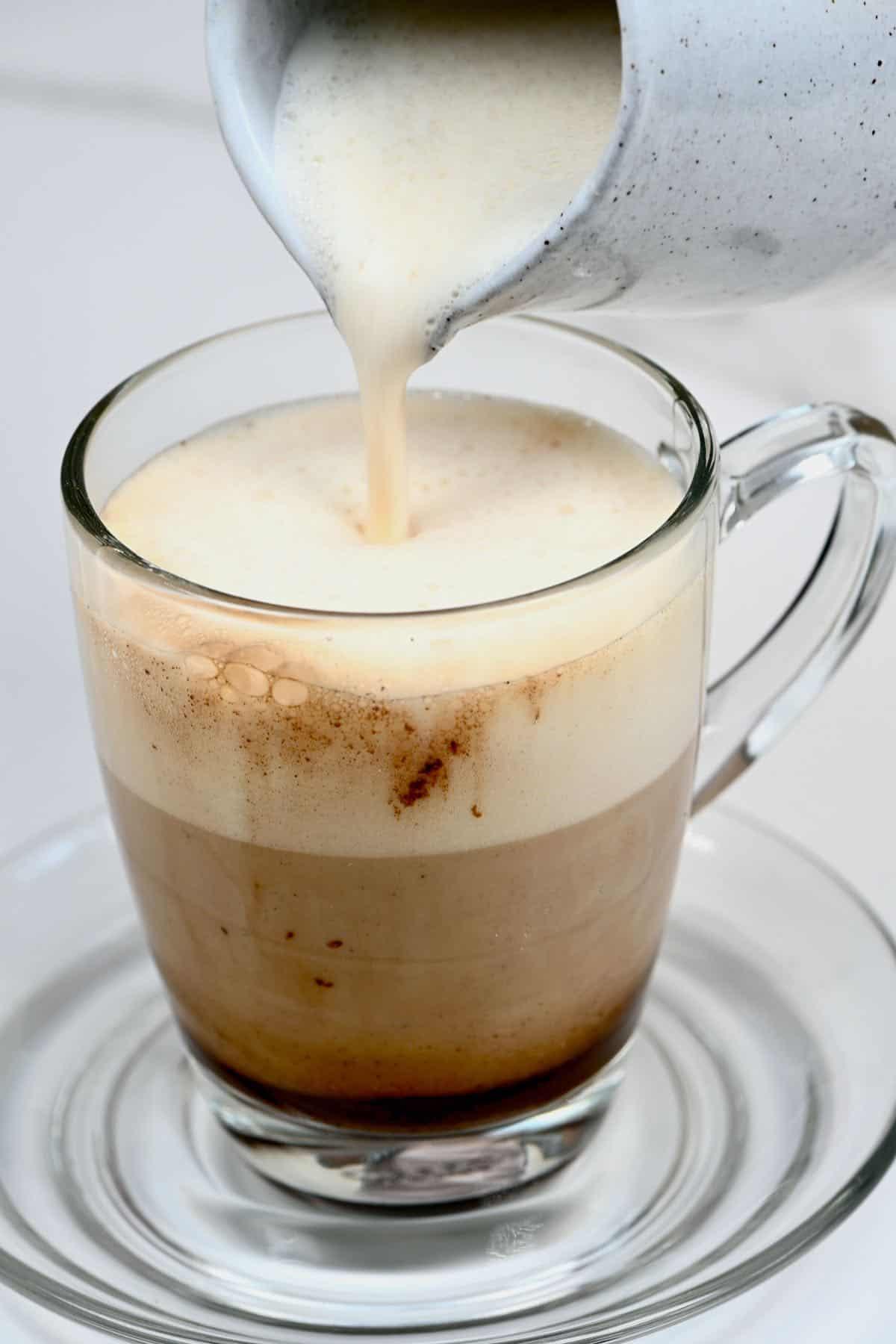 Adding milk for a mushroom latte