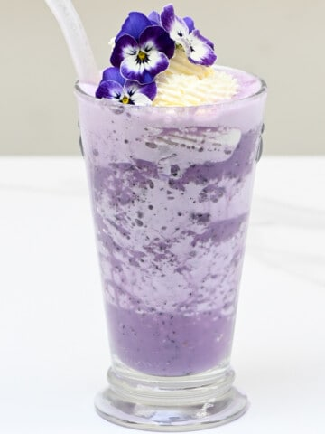Blueberry Milkshake with edible flowers decoration