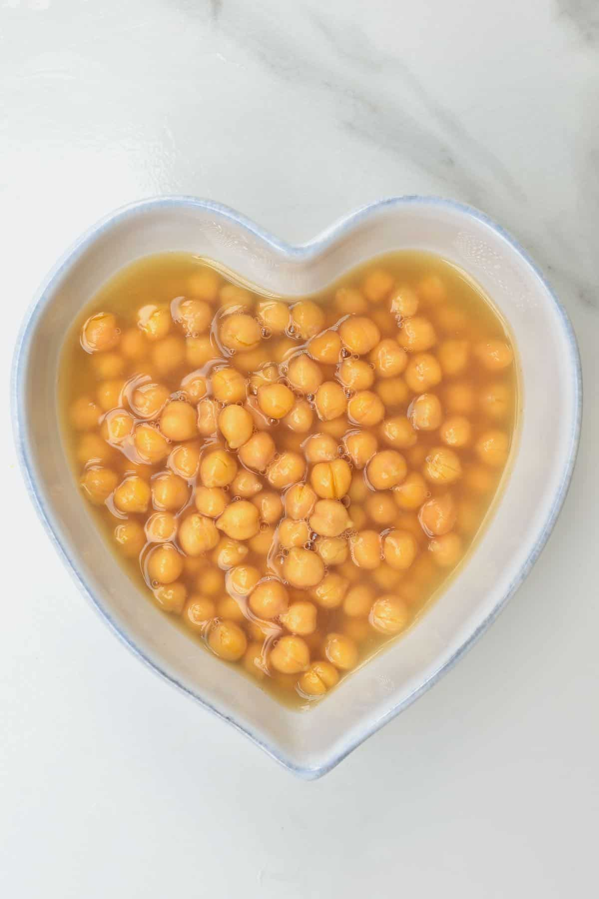 A bowl with cooked chickpeas