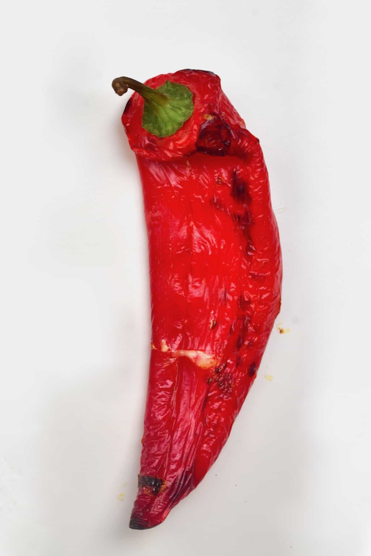 A roasted pepper on a flat surface