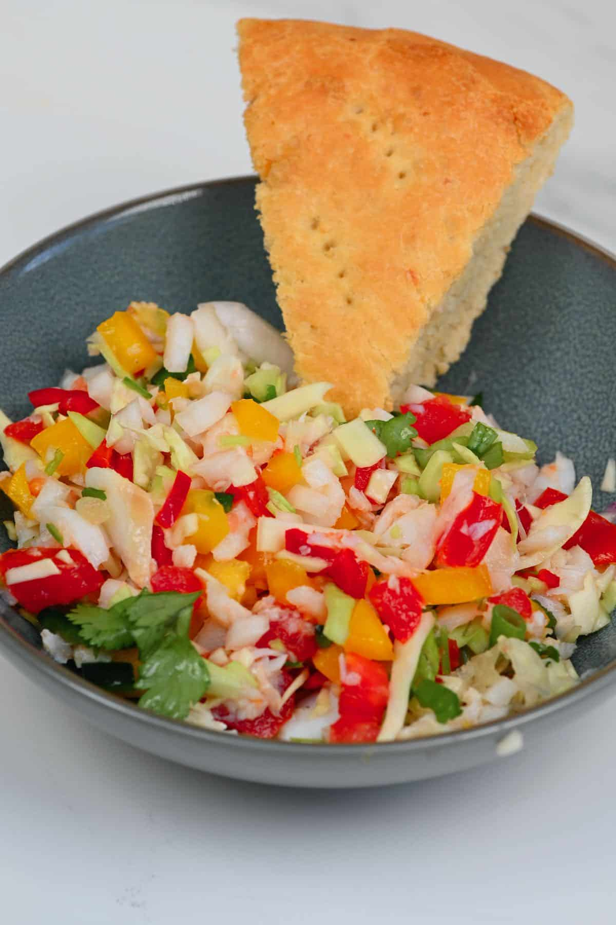 Salted cod salad and a piece of coconut bake