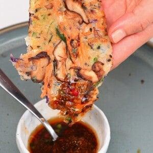 Korean pancake dipped in sauce