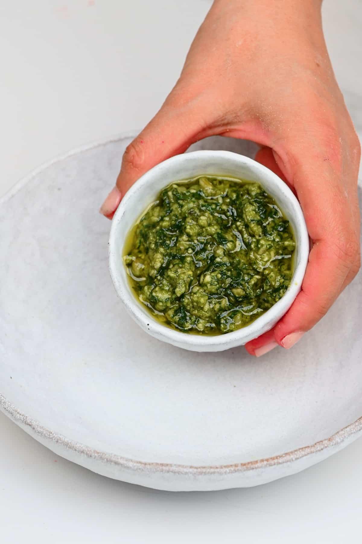 Basil pesto in a small bowl