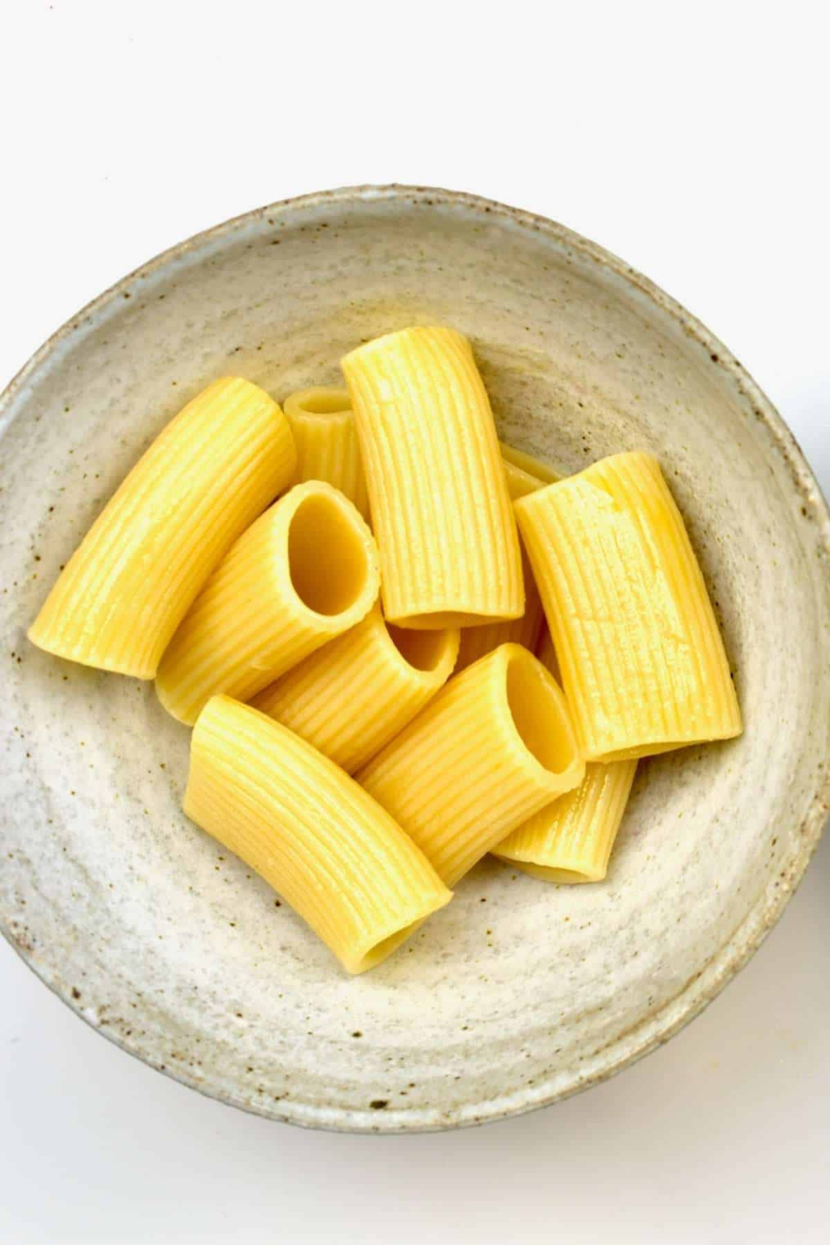 A bowl with cooked pasta