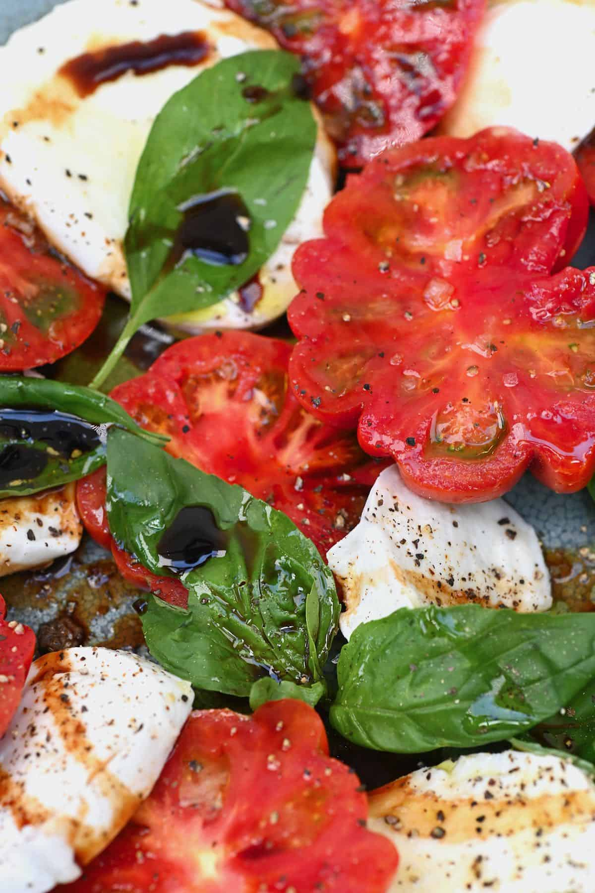 Close up of tomatoes and basil in a caprese salad