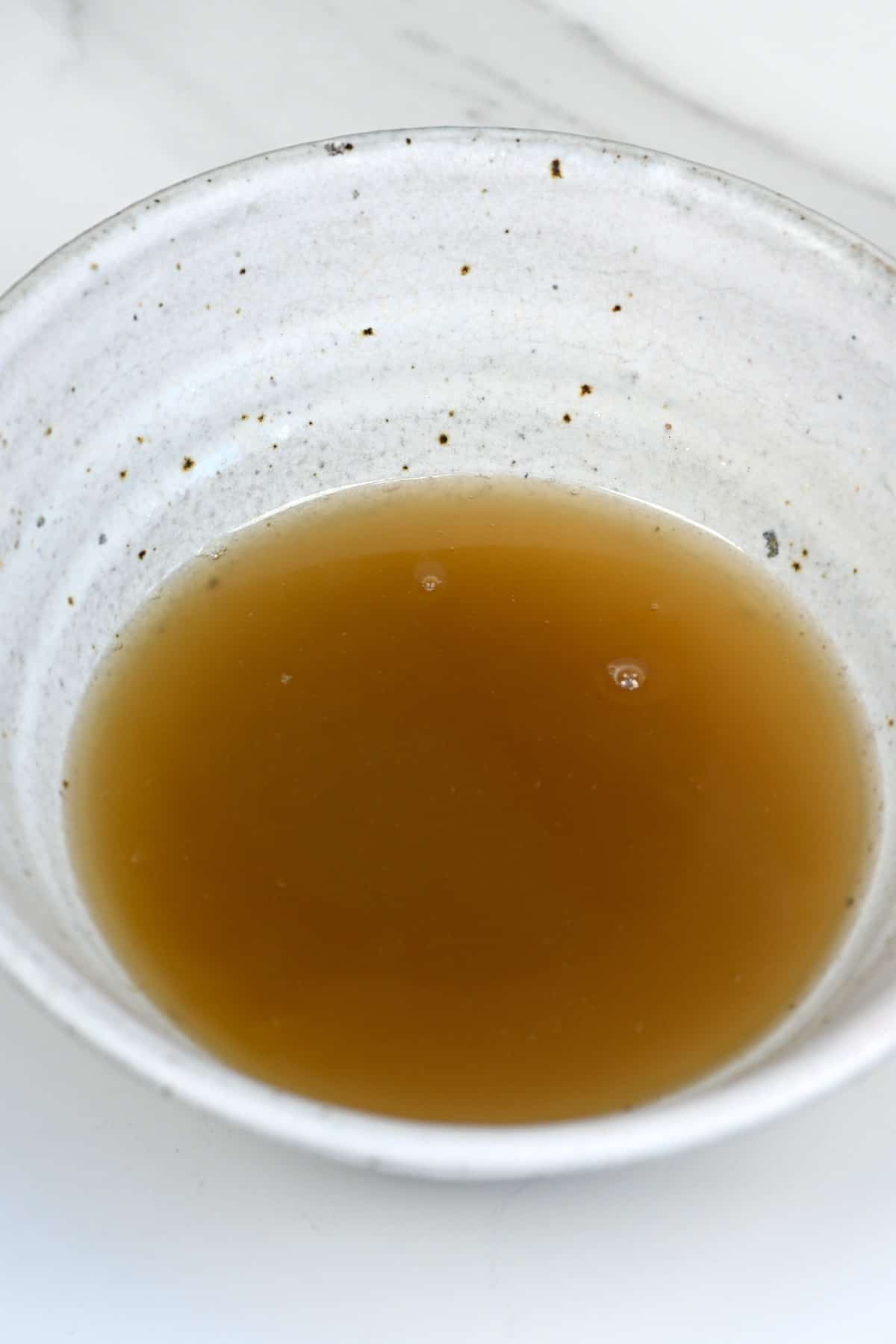 A bowl with ginger syrup