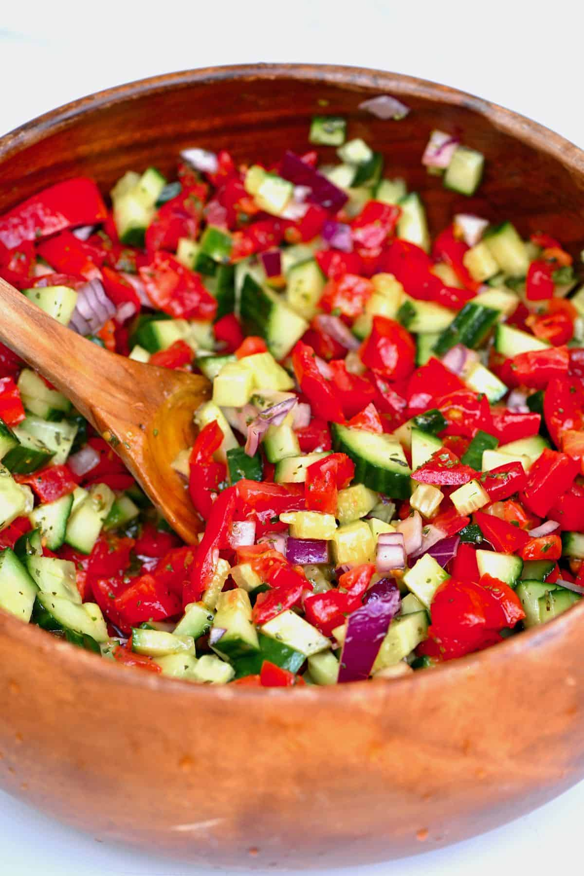 Mixing shirazi salad